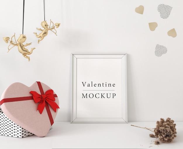 Maqueta de marco con composición de objetos de san valentín