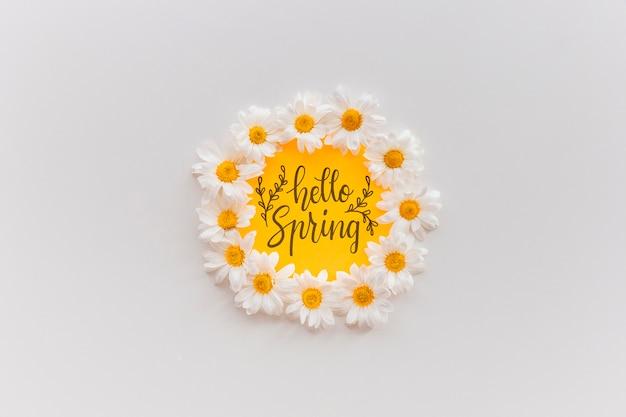 Maqueta de marco con flores de primavera