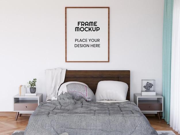 Maqueta de marco de fotos en blanco en el dormitorio