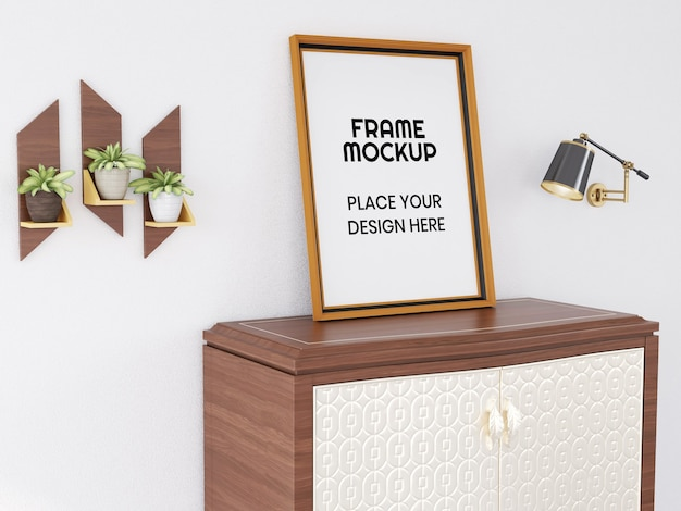 Maqueta de marco de fotos en blanco en el escritorio