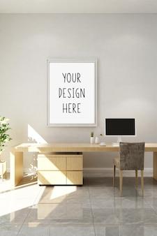 Maqueta marco de fotos en blanco en el espacio de trabajo