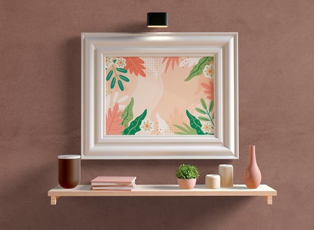 Maqueta de marco de fotos blanco en la pared