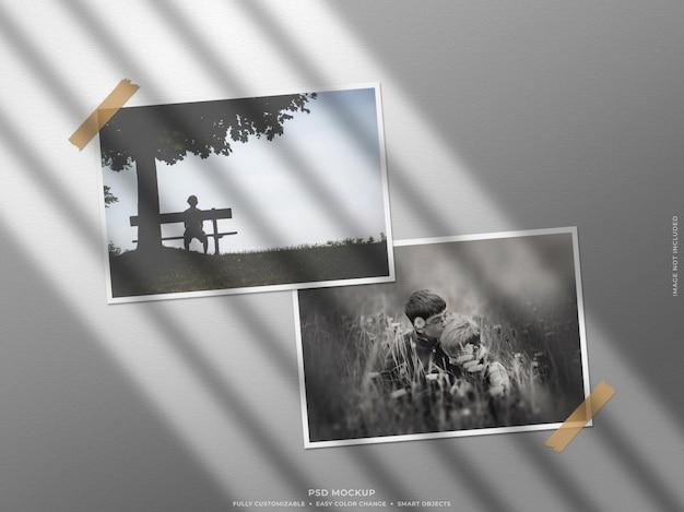 Maqueta de marco de fotos de papel con sombra en la pared