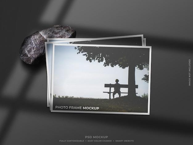 Maqueta de marco de fotos de papel con sombra