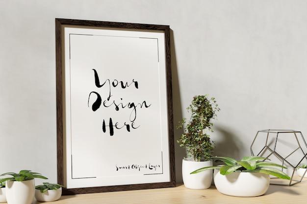 Maqueta de marco de fotos con plantas decorativas