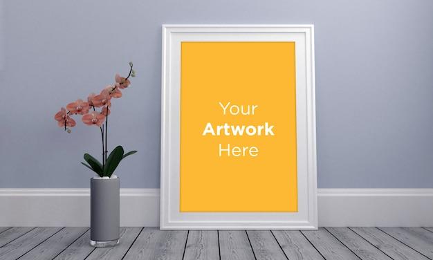 Maqueta de marco de fotos vacío con flor