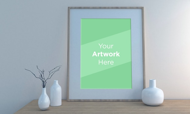 Maqueta de marco de fotos vacío con jarrones blancos