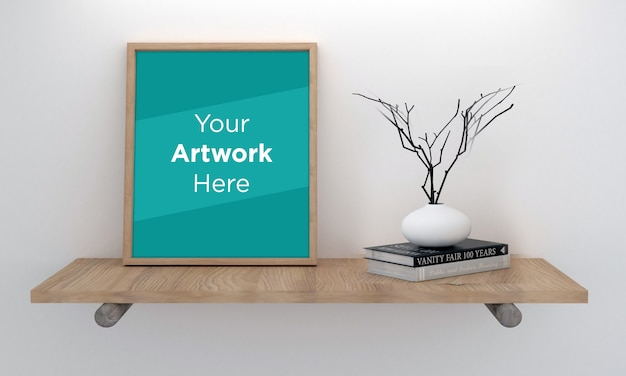 Maqueta de marco de fotos vacío tendido en el estante