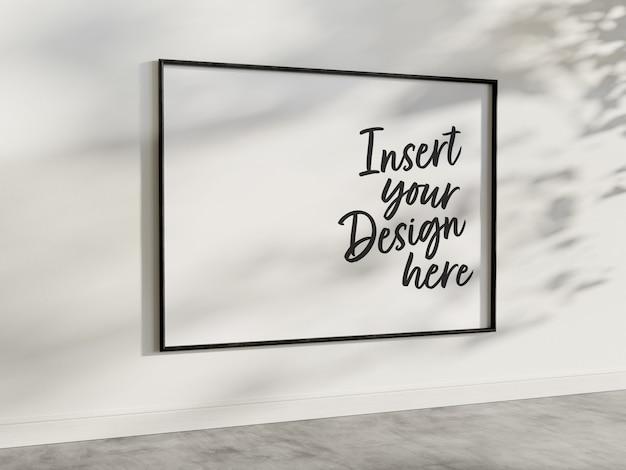 Maqueta de marco horizontal colgado en la pared