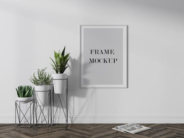 Maqueta de marco de imagen blanco al lado de plantas