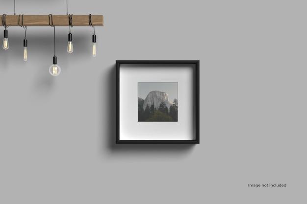 Maqueta de marco de imagen cuadrado en la pared