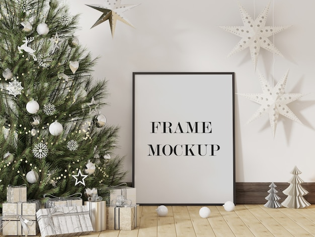 Maqueta de marco de imagen junto al árbol de navidad