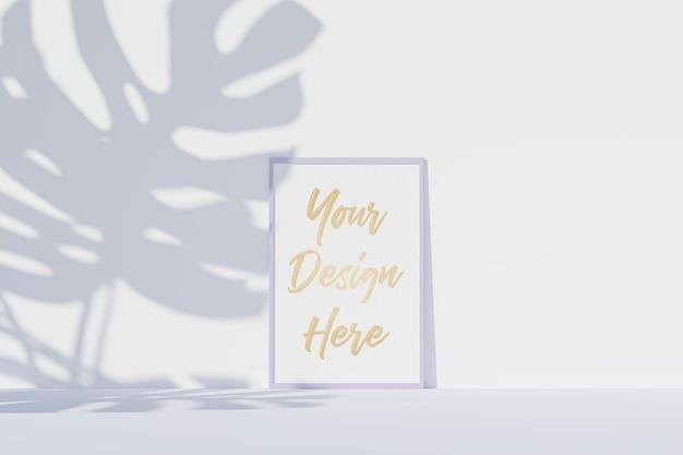 Maqueta de marco de imagen con papel blanco y sombra de hojas de monstera