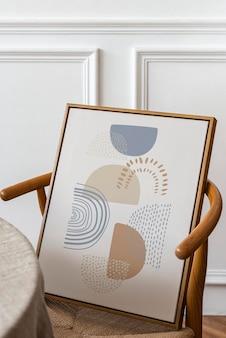 Maqueta de marco de imagen psd en una silla retro