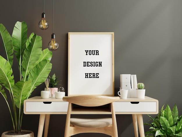 Maqueta de marco negro en la mesa de trabajo en el interior de la sala de estar sobre fondo de pared oscura vacía, renderizado 3d
