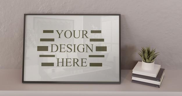 Maqueta de marco negro de pie sobre una mesa blanca con libros y sucesivos. marco vertical