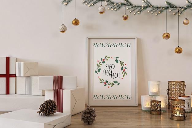 Maqueta de marco de póster con decoración navideña y regalos.