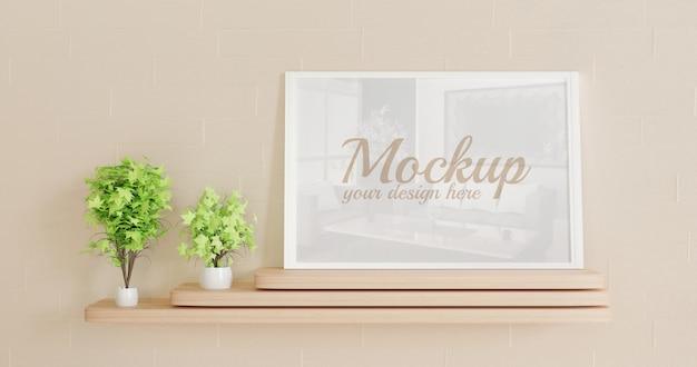 Maqueta de marco vertical blanco de pie sobre el escritorio de madera con plantas decorativas