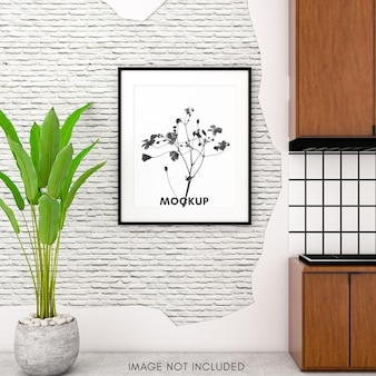 Maqueta de marco vertical en pared de ladrillo brillante en cocina