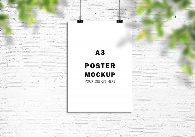 Maqueta de marcos de póster en pared de ladrillo