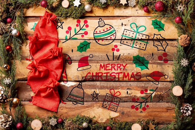 Maqueta de mensaje de feliz navidad sobre fondo de madera