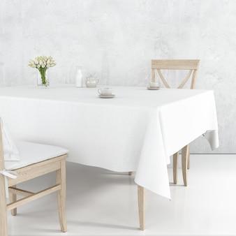 Maqueta de mesa de comedor con tela blanca y sillas de madera.
