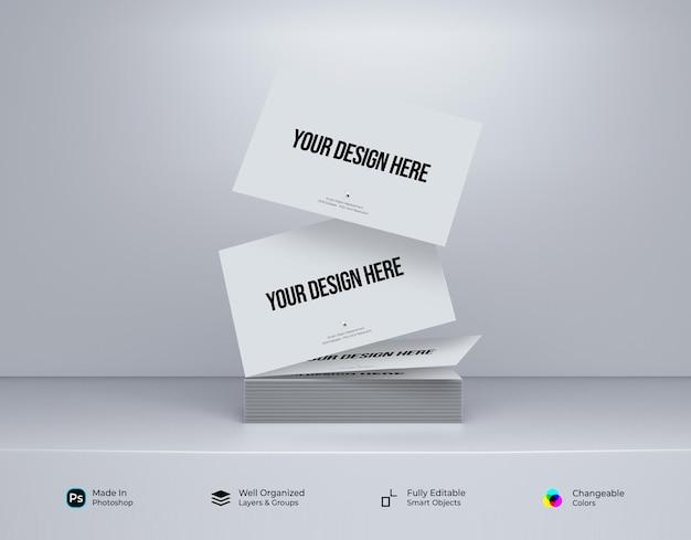 Maqueta minimalista de tarjeta de visita cayendo al suelo