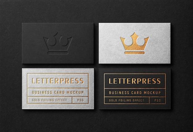 Maqueta moderna y lujosa de tarjetas de visita con efecto dorado tipográfico