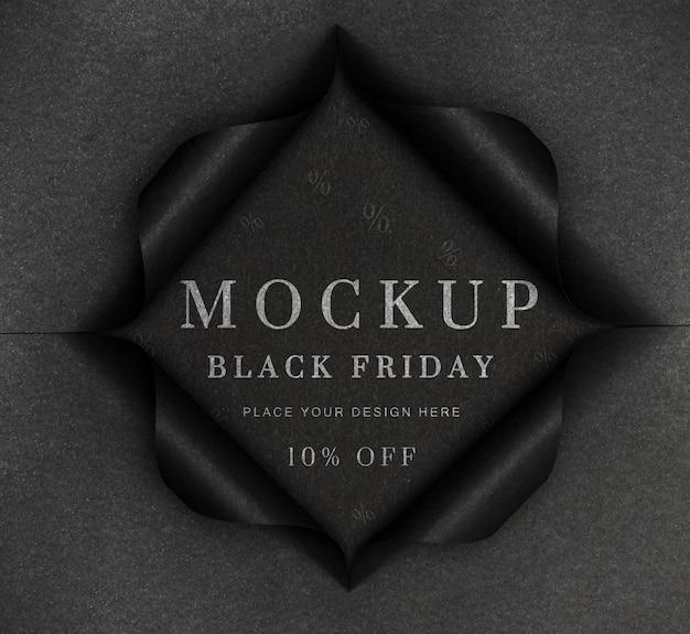 Maqueta negra y papel rasgado viernes negro