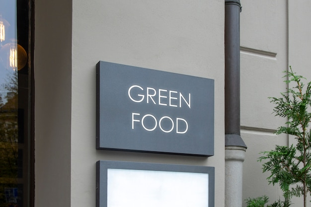 Maqueta de outdoor street urban logo sign en la pared