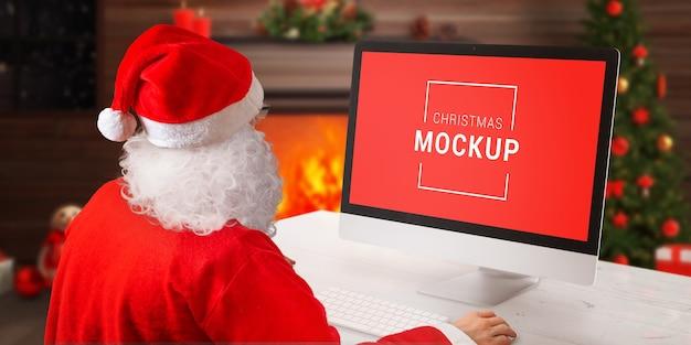 Maqueta de pantalla de computadora navideña con santa claus