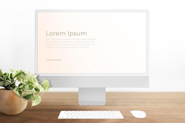 Maqueta de pantalla de escritorio de computadora psd wfh espacio de trabajo con planta