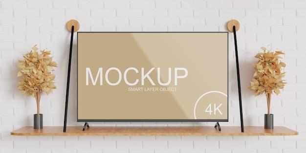 Maqueta de pantalla de tv de pie en la mesa de la pared
