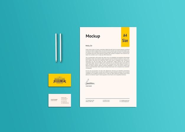 Maqueta de papel a4 y tarjeta de visita
