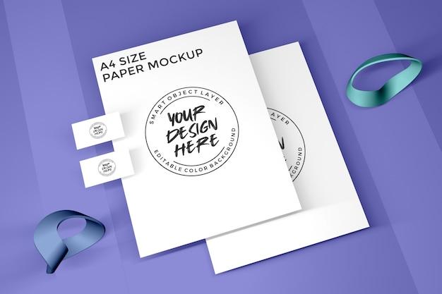 Maqueta de papel a4 y tarjetas de visita
