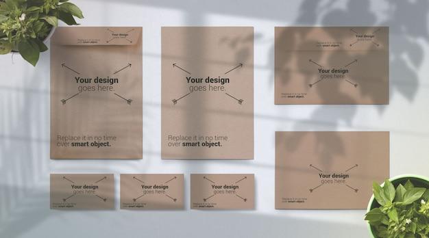 Maqueta de papelería con branding design branch shadow overleaf