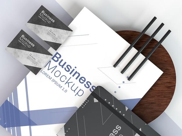 Maqueta de papelería empresarial y lápices.