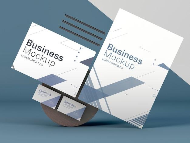 Maqueta de papelería empresarial sobre fondo azul