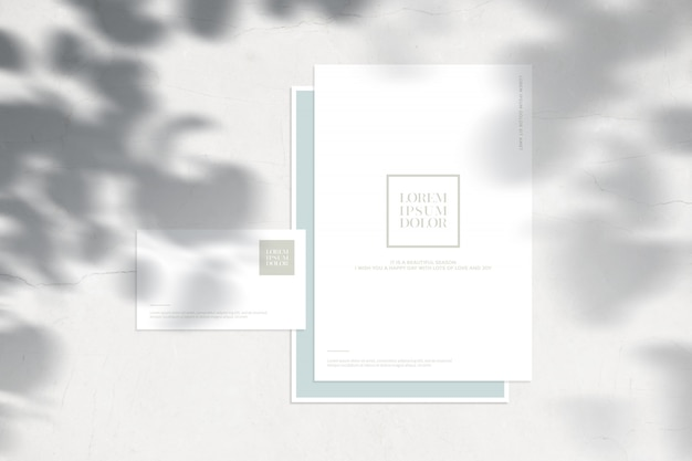 Maqueta de papelería con hojas de sombras