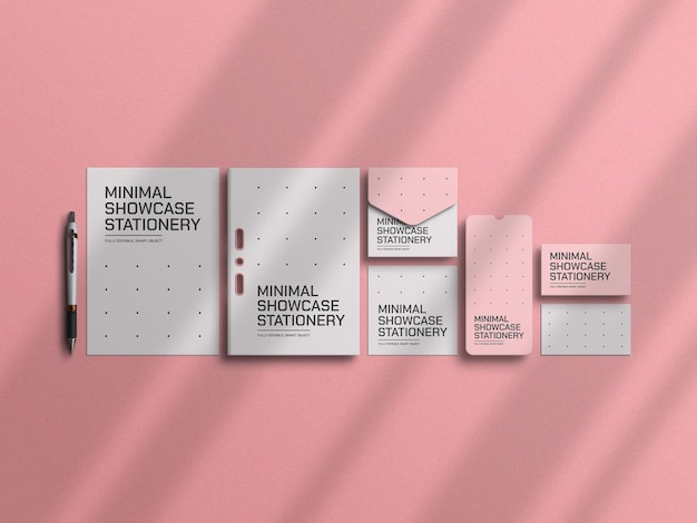 Maqueta de papelería rosa mínima
