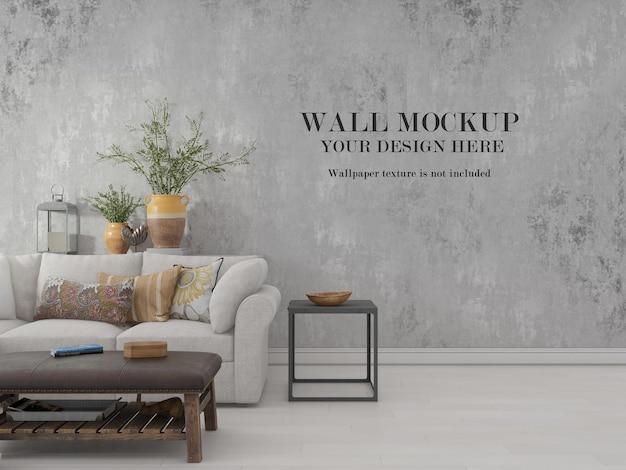 Maqueta de pared detrás de plantas y sofá.