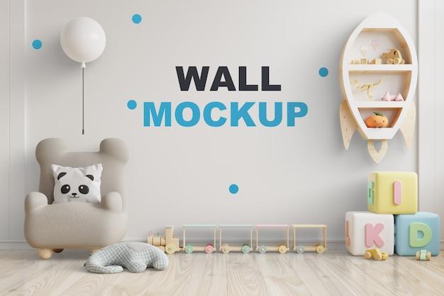 Maqueta de pared en la habitación de los niños en la pared de colores blancos. representación 3d