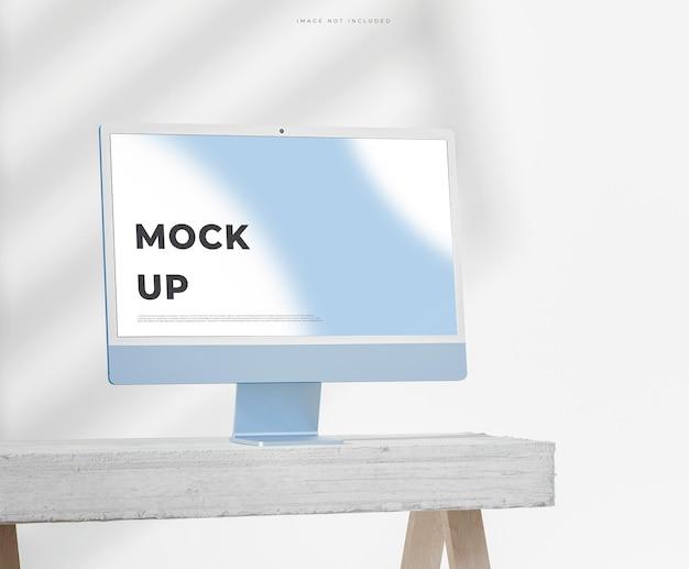 Maqueta de pc de escritorio azul moderna para la marca en la mesa de hormigón blanco render 3d