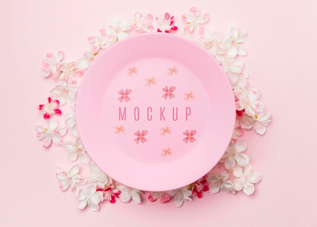 Maqueta de placa rosa rodeada de flores de jazmín