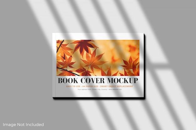 Maqueta de portada de libro a4 horizontal con sombra