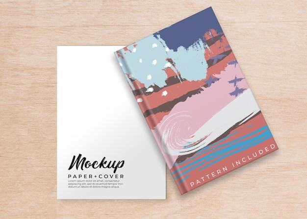 Maqueta de portada de libro y hoja de papel