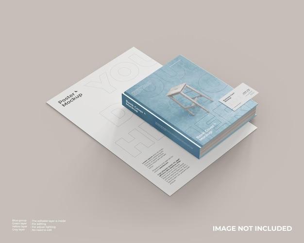 Maqueta de portada de libro con póster debajo y tarjeta de presentación sobre el libro