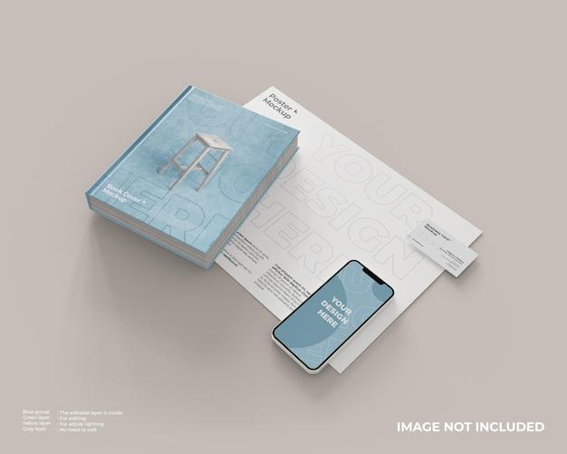 Maqueta de portada de libro, teléfonos inteligentes y tarjetas de visita en la maqueta de póster