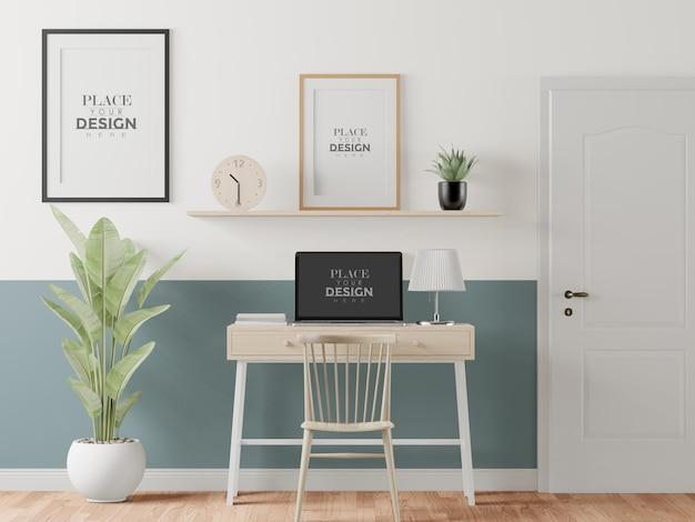 Maqueta de portátil en el escritorio en el espacio de trabajo
