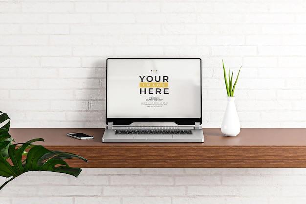 Maqueta de portátil habitación pared de ladrillo blanco 3d realista